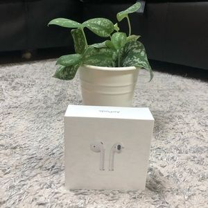 AirPods w/ charging case.Brand new factory sealed